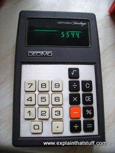 A 1970s pocket calculator with a green vacuum fluorescent display.