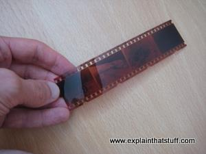 A strip of old 35mm photographic film based on silver chemicals.