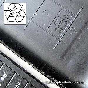 A cellphone case made from black ABS plastic with the ABS recycling symbol inset