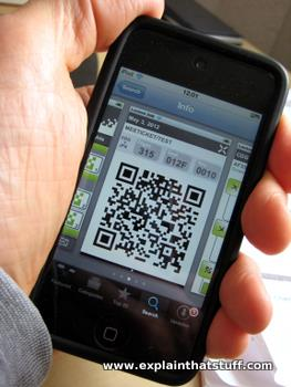 A mobile boarding pass displayed on the screen of an iPhone.
