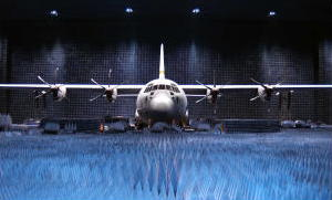 An airplane under test in a giant anechoic chamber.