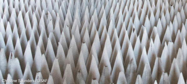 White energy absorbing wedges in an anechoic (sound-absorbing) test chamber.