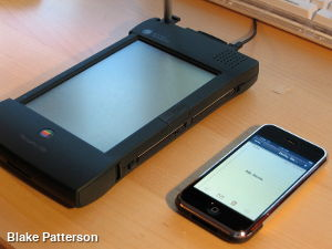 An Apple Newton next to an Apple iPhone.