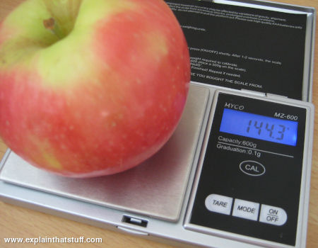 An apple weighed on a precise electronic balance.