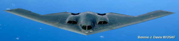 B2 stealth bomber designed to avoid radar, front view of plane, photographed against a blue sky