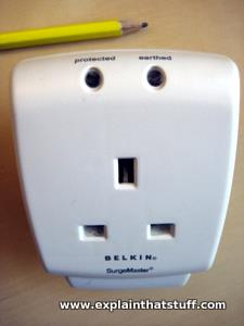 Closeup of a Belkin surge protector showing the indicator lights.