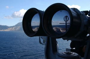 Large US navy binoculars looking out to sea