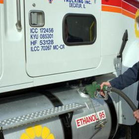 A man fills up a truck with ethanol biofuel
