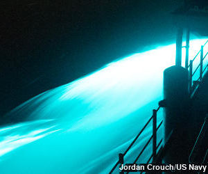 Bright blue bioluminescence photographed off the side of a ship in the East China Sea.