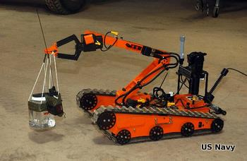 Orange bomb disposal robot EODMU8 carrying a suspect bomb to safety