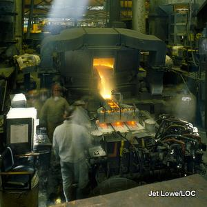 Casting brass alloys in a furnace at American Brass Foundry. Photo by Jet Lowe/LOC