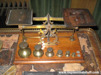 Brass postal scales and weights for weighing letters before posting.