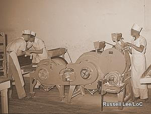 A machine for making bread rolls photographed in 1939.