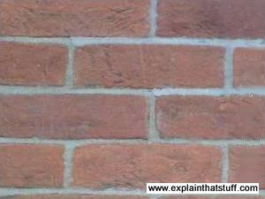 Closeup of traditional red-brown brick wall.