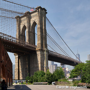 A stone tower supporting the Brooklyn Bridge, viewed from the Brooklyn side of the span. Photo by Carol M. Highsmith