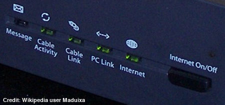 Detail of the indicator lights on a Thomson broadband cable modem.