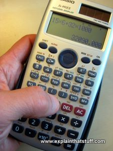 A Casio scientific calculator with a finger pressing the buttons.