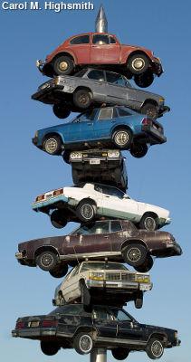 A large metal spike with cars on it. The Berwyn car spindle, Berwyn, Illinois by Carol M. Highsmith.