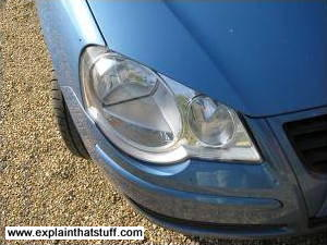 A close-up of a car headlamp showing the lenses inside