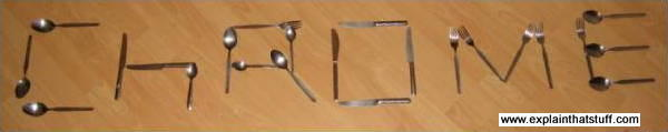 Photo of the word 'chrome' spelled out in forks, knives, spoons, and other stainless steel cutlery.