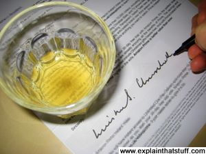 Simulation of Winston Churchill's signature on a letter with a drink on top