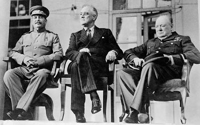 Roosevelt, Stalin, and Churchill on portico of Russian Embassy in Teheran, during conference, Nov. 28 - Dec. 1, 1943