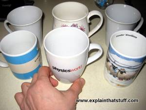 Six coffee mugs lined up to represent the displacement of a two-liter car engine