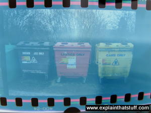A 35mm film positive of recycling dumpsters.