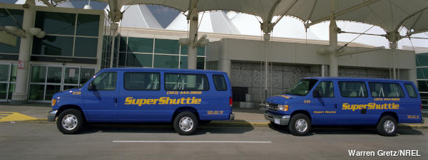 Two blue Colorado SuperShuttle airport taxis operating on LPG alternate fuel