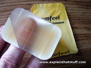 A Comfeel hydrocolloidal ulcer dressing resting on a person's fingers