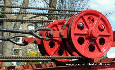 Giant pulley wheels in a large crane
