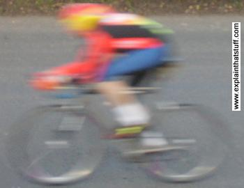 Photo of a speed cyclist wearing a helmet.