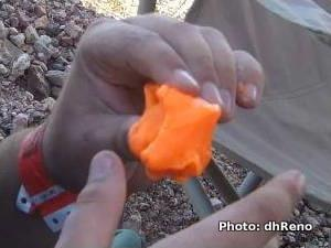Photo of D3O energy-absorbing plastic polymer being molded by hand.