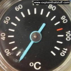 A dial thermometer in a gas boiler
