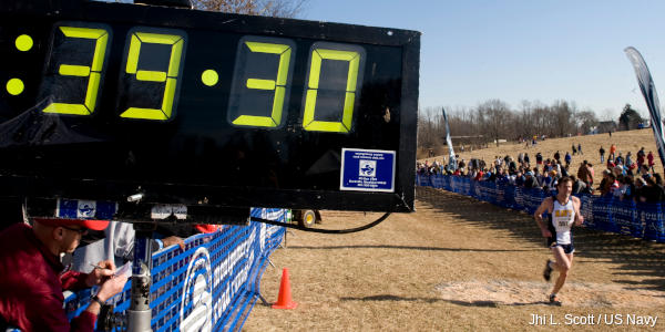 A large digital clock timing runners in a race.