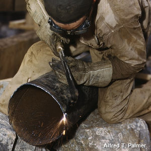 A welder working on a pipe at the Douglas Dam Tennessee (TVA) in 1942. Photo by Alfred T. Palmer