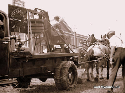 A truck-mounted dynamometer being used at a horse-pulling contest.