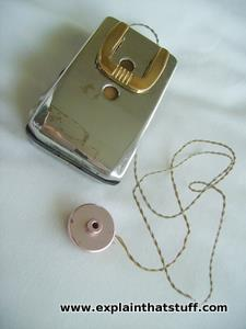 A basic pocket-style analog hearing aid with earpiece attached by wire.