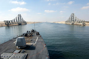 A US Navy ship sails through the El Ferdan Swing Bridge on the Suez Canal in Egypt
