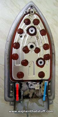 Photo of the soleplate of an electric iron, showing the connections to the heating element.