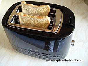 Electric toaster with two slices of bread popped up