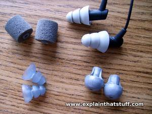 Etymotic HF5 noise-isolating earbuds and different sized earplugs that come with them.