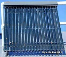 Photo of evacuated tube solar thermal collector on house roof.