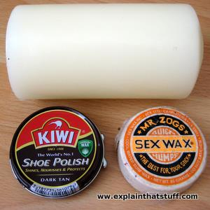 Three common types of wax: a beeswax candle, a carnauba wax shoe polish tin, and surf wax made from paraffin and beeswax.