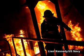 Firefighter in silhouette surrounded by flames