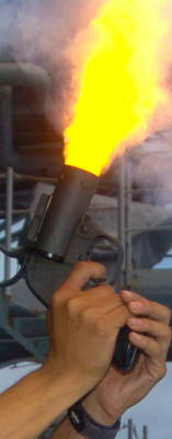 A flare gun being fired from a ship.