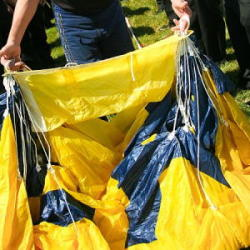 A US navy parachute team member demonstrates how to pack a parachute correctly.