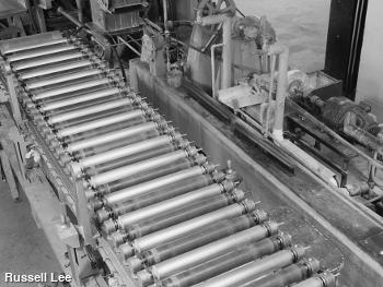 Paper rollers in a Fourdrinier machine. Photo by Russell Lee.