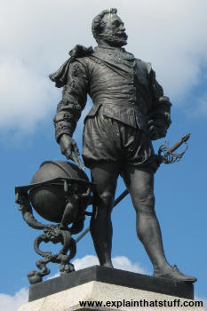 Sir Francis Drake and globe statue againt a blue sky at Plymouth Hoe, England.