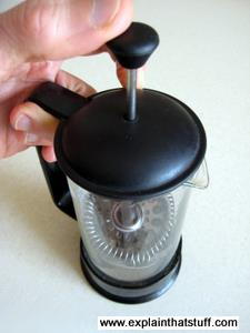A French press cafetiere, showing the metal gauze inside